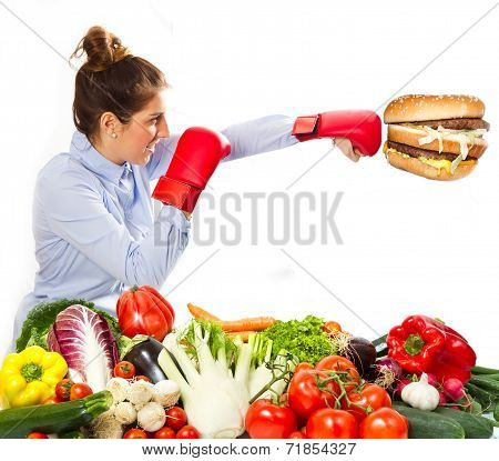a young woman boxing with hamburger for diet poster