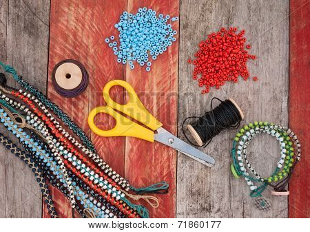 bead making accessories on grunge wood background