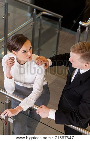 Man Holding Arm Of His Co-worker