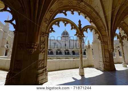 Jeronimos Monastery Cloister with Manueline style at summer. Jeronimos Monastery (Portuguese: Mosteiro dos Jeronimos) was completed in 1544 and is UNESCO World Heritage Site at Belem district, Lisbon, Portugal poster