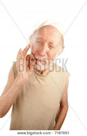 Senior man in ragged shirt smoking cigarette stub or marijuana reefer poster