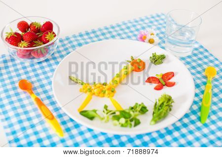 Healthy vegetarian lunch for little kids vegetables and fruit served as animals corn broccoly carrots and fresh strawberry helping children to learn eating right and clean poster