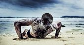 young man with a zombie body painting, covered with blood on the beach  (halloween topic) poster