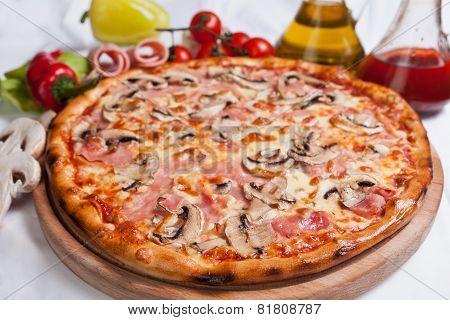 Pizza With Mozzarella, Ham And Mushrooms