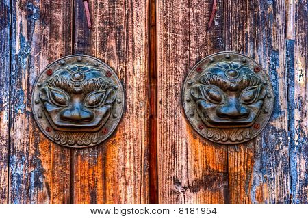 Old metal door knob with anuml pattern at Wu Zhen in China poster