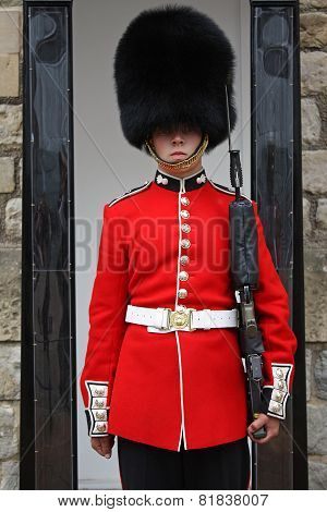 London's Queen Guard In Red Uniform Standing At His Post