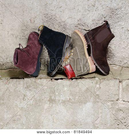 Set of man footwear on a grunge  background
