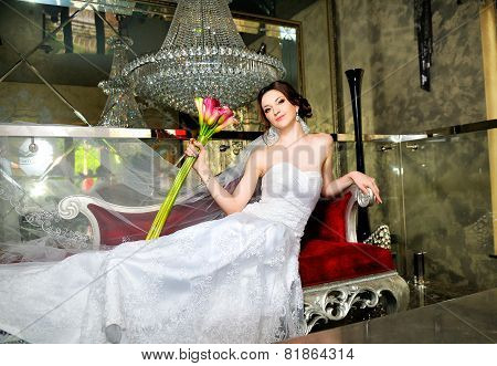 Bride on red velours coach