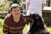 mentally disabled woman is caress a dog poster