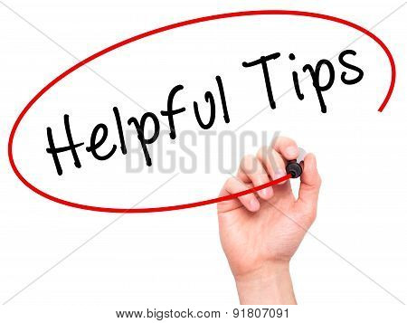 Man hand writing Helpful Tips on visual screen.