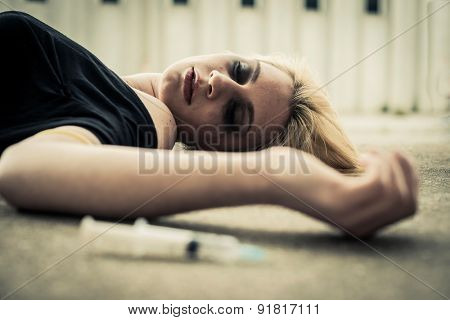 Young woman lying after drug injection