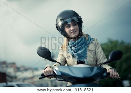 Happy girl on her scooter