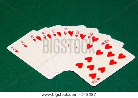 the hearts playing cards on green cloth poster