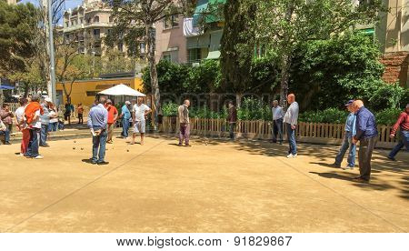 BARCELONA, SPAIN - APRIL, 2015: Seniors playing boule in park in Barcelona