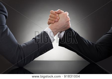 Close-up Of A Two Businessman Competing In Arm Wrestling poster