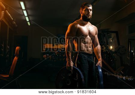 Bodybuilder In The Gym Exercising Barbell