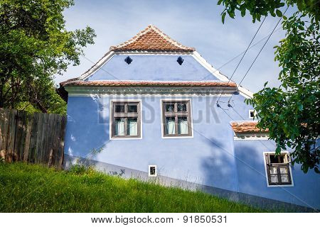 Blue Painted Traditional House From Viscri Village In Transylvania, Romania