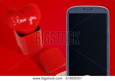 Blue smatrphone and I love you heart on red background. Idea for Valentines Day celebration, love, Father's or Mother's day, love apps, Internet, blogs and others.