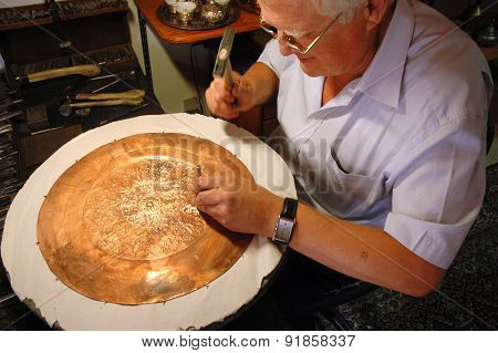 Craftsman Tinkering A Copper Dish In Mostar