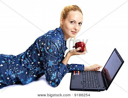 Pretty Woman With Apple And Laptop