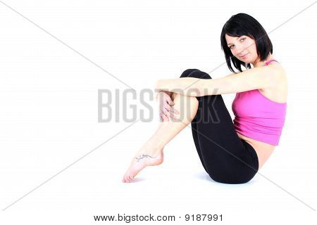 sitting woman in pink t-shirt doing yoga