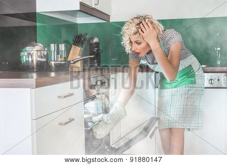 Amazed woman cook frying or roasting something in a oven. Smoke vapor around in the kitchen or home poster