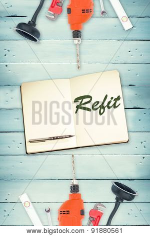 The word refit against tools and notepad on wooden background