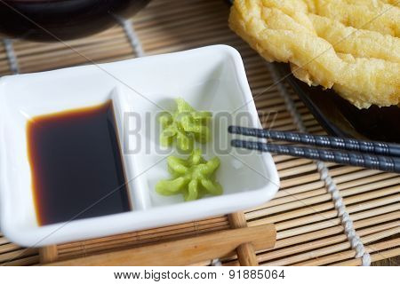 Wasabi and soy sauce on table
