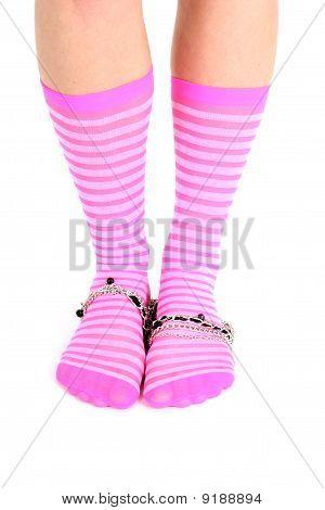 Female Legs In Pink Striped Socks