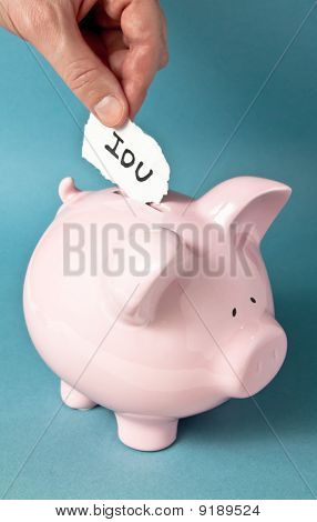 A close up of pink piggy bank on a blue background with a hand placing an IUO paper note into the bank poster