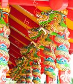 Chinese dragon pillars at Chiness temple in Phuket poster