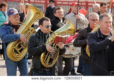 Orel Russia - May 1 2016: Communist party demonstration. Brass band playing and marching closeup