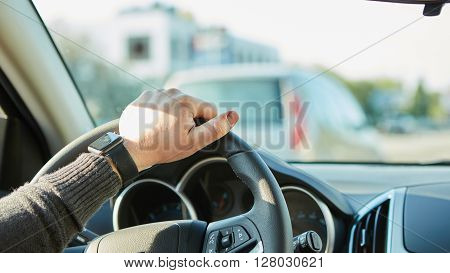 Closeup Of A Man Hands Holding Steering Wheel While Driving Car with retro filter effect