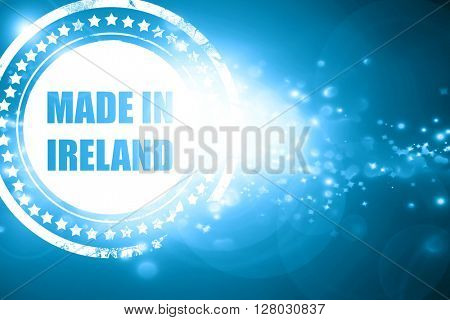 Blue stamp on a glittering background: Made in ireland