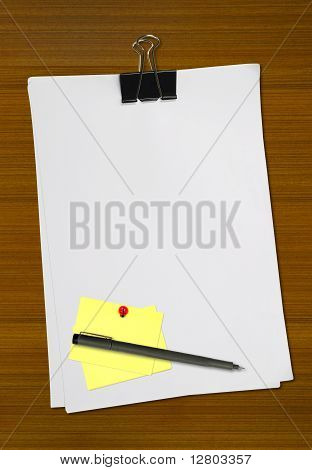 Yellow memo and white blank note paper with pen