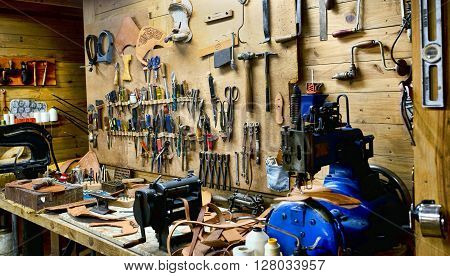 Mans old fashion workshop with lots of hand tools..