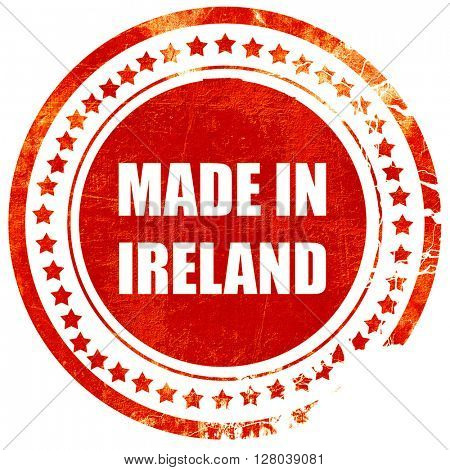 Made in ireland, grunge red rubber stamp on a solid white background