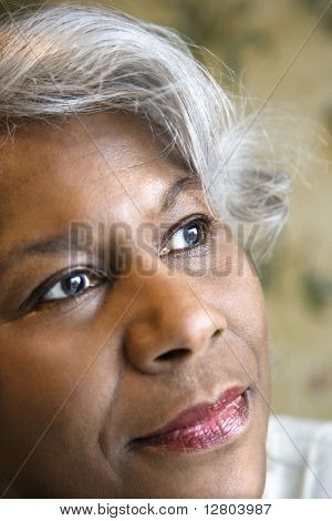 Close up portrait of mature African American woman looking to the side.