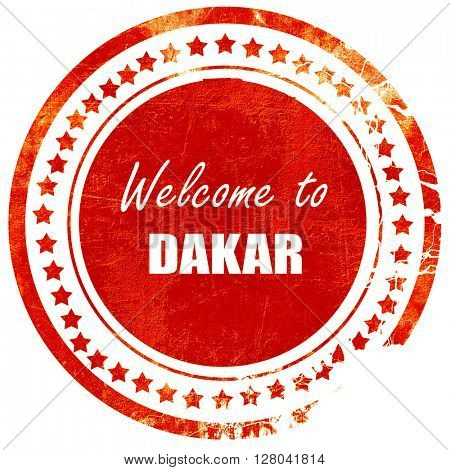 Welcome to dakar, grunge red rubber stamp on a solid white backg