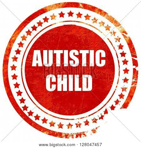 Autistic child sign, grunge red rubber stamp  on a solid white background