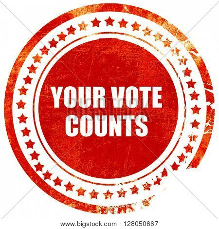 your vote counts, grunge red rubber stamp on a solid white backg