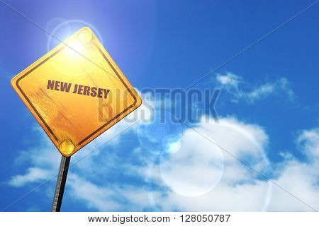 Yellow road sign with a blue sky and white clouds:  new jersey
