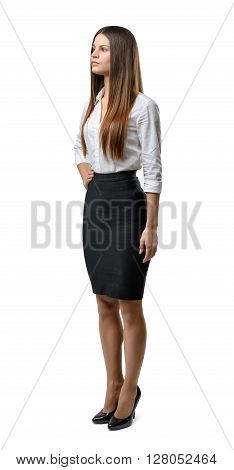 Cutout business woman stands sideway looking up. Success and development. Business staff. Office clothes. Dress code. Beauty and youth.