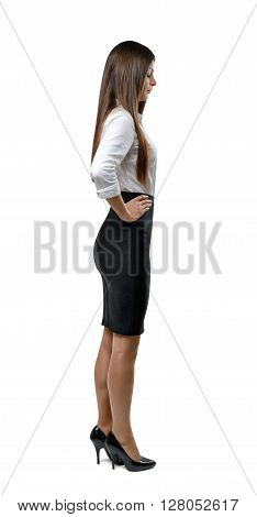 Cutout businesswoman in an office dress standing in profile. Success and development. Business staff. Office clothes. Dress code. Presentable appearance. Beauty and youth. Profile pose.