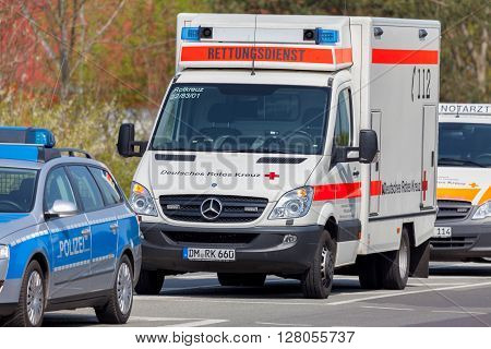 ALTENTREPTOW / GERMANY - 1. MAY 2016: german emergency ambulance and police vehicle stands on the street in altentreptow on may 2016.