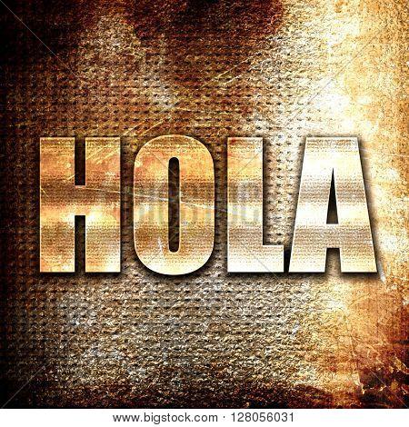 hola, written on vintage metal texture