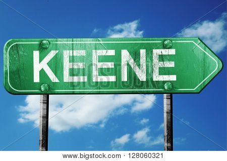 keene road sign , worn and damaged look