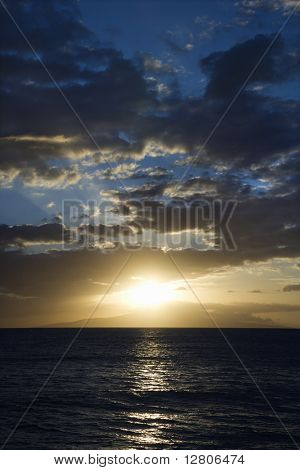 Sunset and clouds over the Pacific Ocean off the coast of Kihei, Maui, Hawaii, USA.