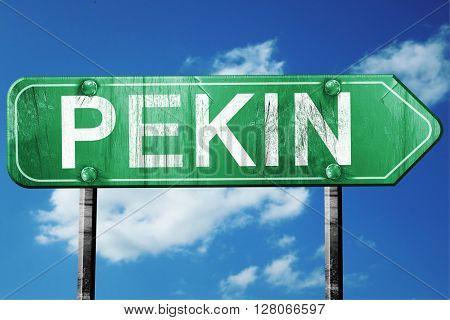 pekin road sign , worn and damaged look
