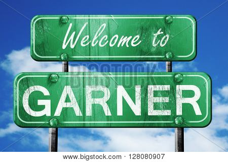garner vintage green road sign with blue sky background